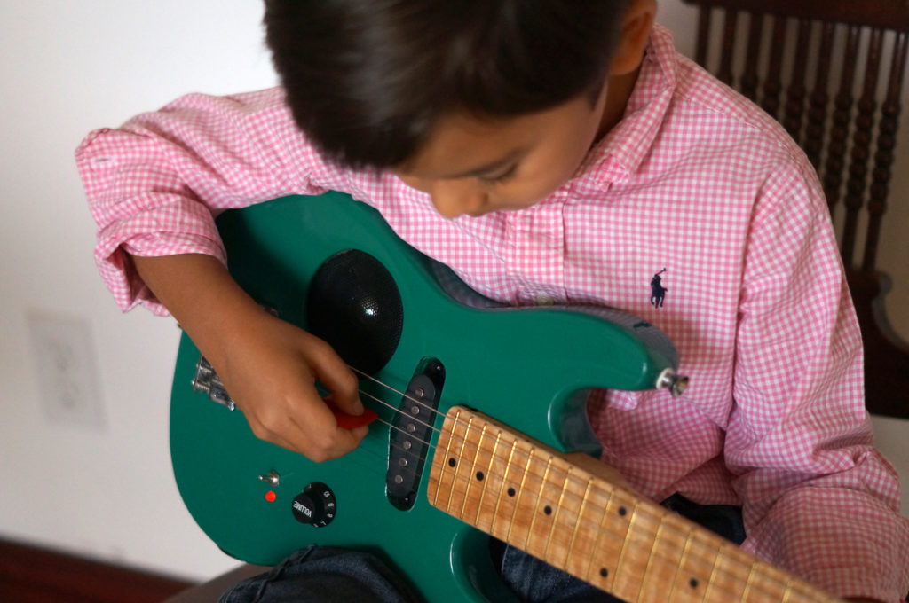 kid-playing-electric-guitar