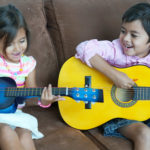 kids guitar lesson having fun
