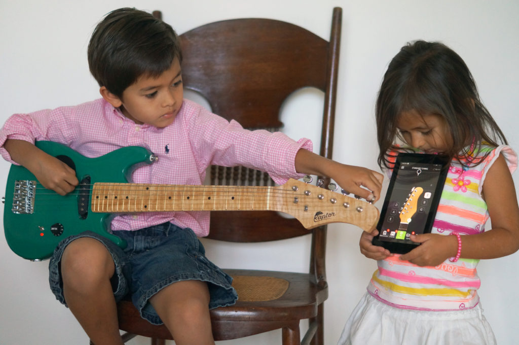 kids tuning electric guitar